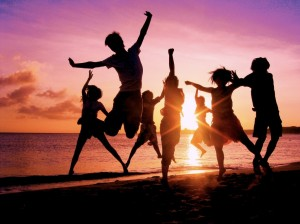 Kids dancing on a beach