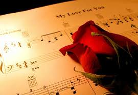 Sheet Music with Red Rose